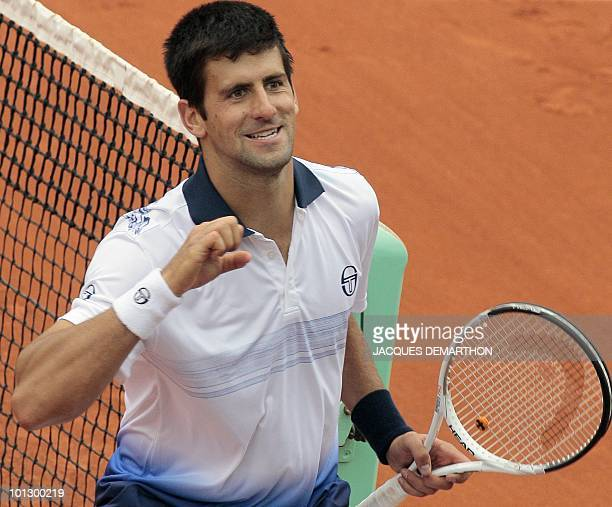 Serbia's Novak Djokovic celebrates after winning his men's fourth round match against US Robby Ginepri in the French Open tennis championship at the...
