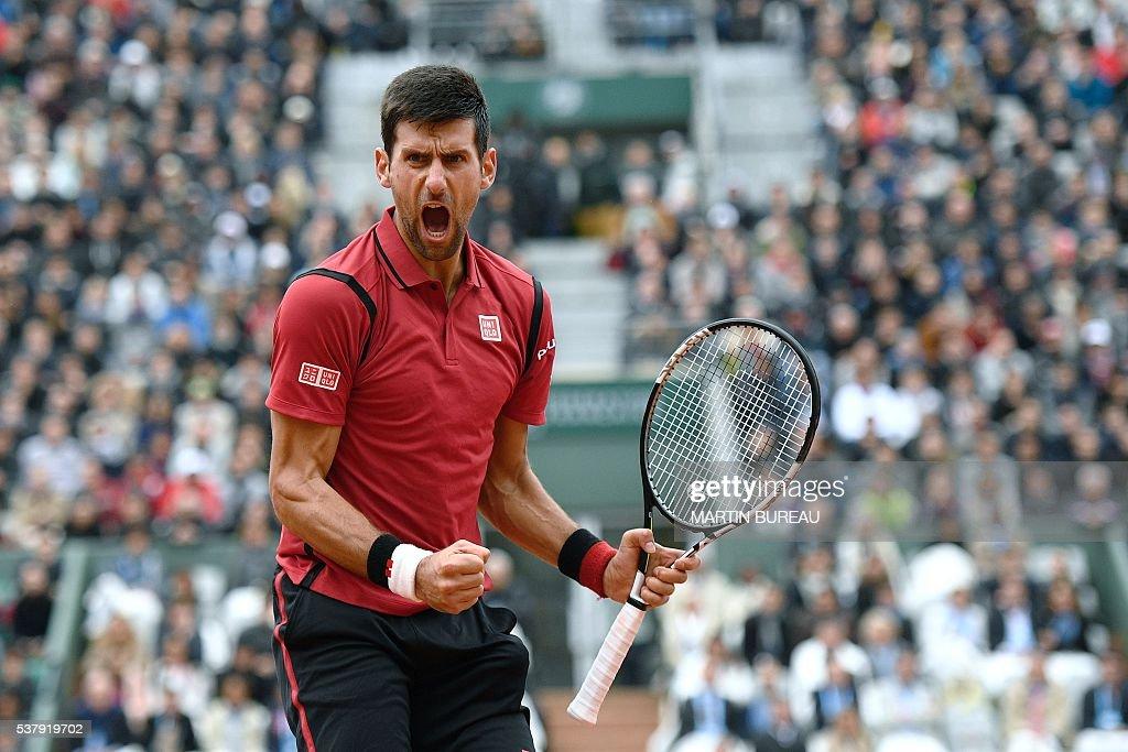 Serbia's Novak Djokovic celebrates after winning his men's semi-final match against Austria's Dominic Thiem at the Roland Garros 2016 French Tennis Open in Paris on June 3, 2016. / AFP / MARTIN