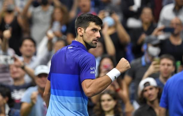 Serbia's Novak Djokovic celebrates after winning the match against Italy's Matteo Berrettini during their 2021 US Open Tennis tournament men's...