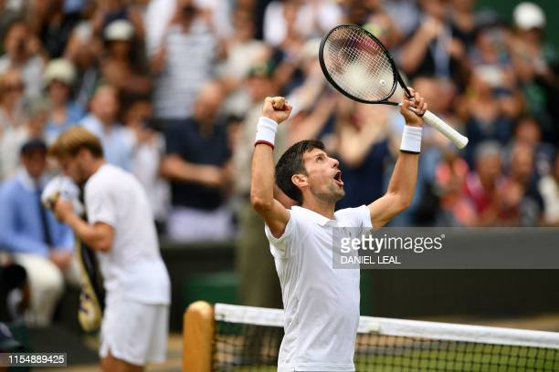 TOPSHOT Serbia's Novak Djokovic celebrates beating Belgium's David Goffin during their men's singles quarterfinal match on day nine of the 2019...