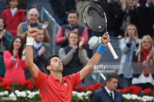 Serbia's Novak Djokovic celebrates beating Britian's Andy Murray during the Madrid Open men's tennis final at the Caja Magica sports complex in...