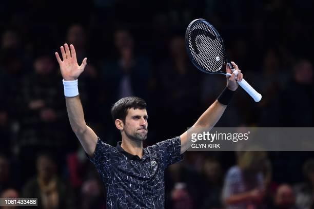 TOPSHOT Serbia's Novak Djokovic celebrates beating Germany's Alexander Zverev during their mens singles roundrobin match on day four of the ATP World...