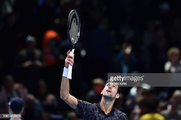 Serbia's Novak Djokovic celebrates beating Germany's Alexander Zverev during their mens singles roundrobin match on day four of the ATP World Tour...