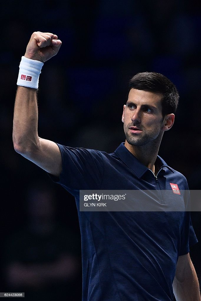 Serbia's Novak Djokovic celebrates beating Japan's Kei Nishikori during their men's semi-final singles match on day seven of the ATP World Tour Finals tennis tournament in London on November 19, 2016. / AFP / Glyn KIRK