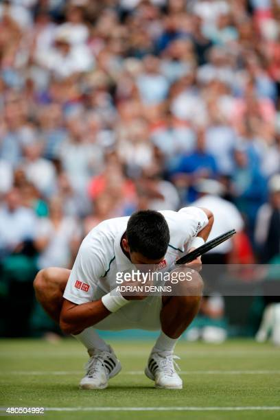 Serbia's Novak Djokovic celebrates beating Switzerland's Roger Federer by eating a blade of grass after their men's singles final match on Centre...