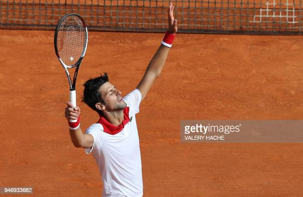 Serbia's Novak Djokovic celebrates defeating compatriot Dusan Lajovic during their round of 64 tennis match at the MonteCarlo ATP Masters Series...