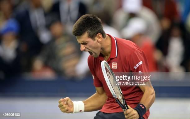 Serbia's Novak Djokovic celebrates his victory against Mikhail Kukushkin of Kazakhstan after their men's singles third round match at the Shanghai...