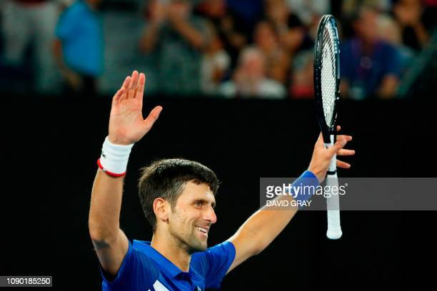 Serbia's Novak Djokovic celebrates his victory against Spain's Rafael Nadal during the men's singles final on day 14 of the Australian Open tennis...