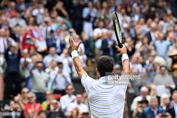 Serbia's Novak Djokovic celebrates his victory over South Africa's Kevin Anderson during their men's singles second round match on the third day of...