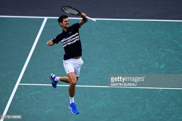 Serbia's Novak Djokovic celebrates winning against Canada's Denis Shapovalov during their men's singles final tennis match at the ATP World Tour...