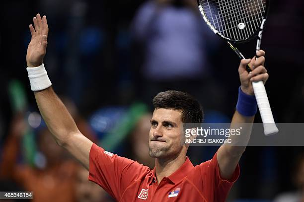 Serbia's Novak Djokovic celebrates winning against Croatia's Mate Delic during their Davis Cup World Group first round one single tennis match in the...