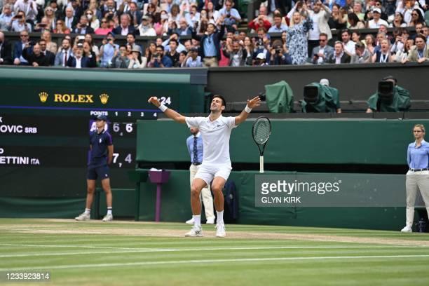 Serbia's Novak Djokovic celebrates winning against Italy's Matteo Berrettini during their men's singles final match on the thirteenth day of the 2021...