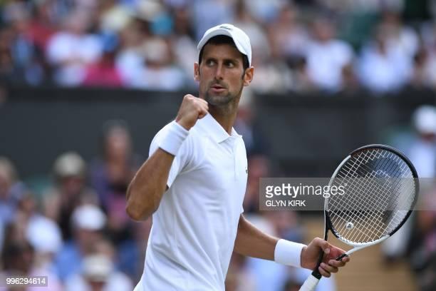 Serbia's Novak Djokovic celebrates winning the third set against Japan's Kei Nishikori during their men's singles quarter-finals match on the ninth...