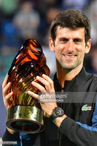 Serbia's Novak Djokovic celebrates with the trophy after he winning the Mubadala World Tennis Championship 2018 final in Abu Dhabi on December 29...