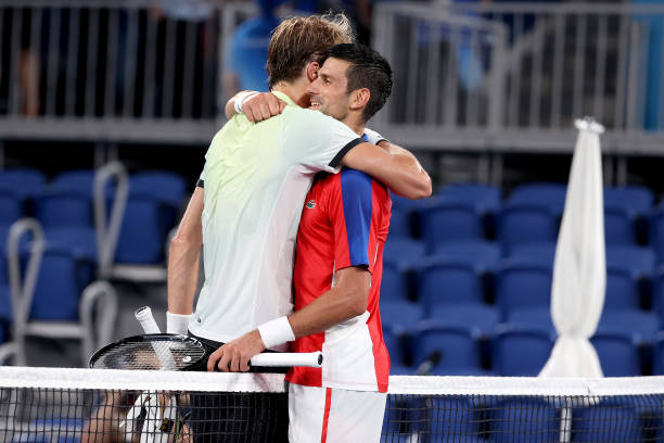 Serbia's Novak Djokovic congratulates Germany's Alexander Zverev for his Tokyo Olympic singles semifinal victory on day seven of the Tokyo 2020...