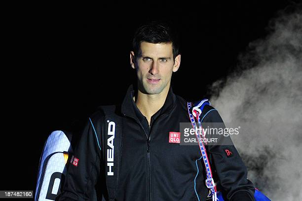 Serbia's Novak Djokovic enters the court to play against France's Richard Gasquet during their group B singles match in the round robin stage on the...