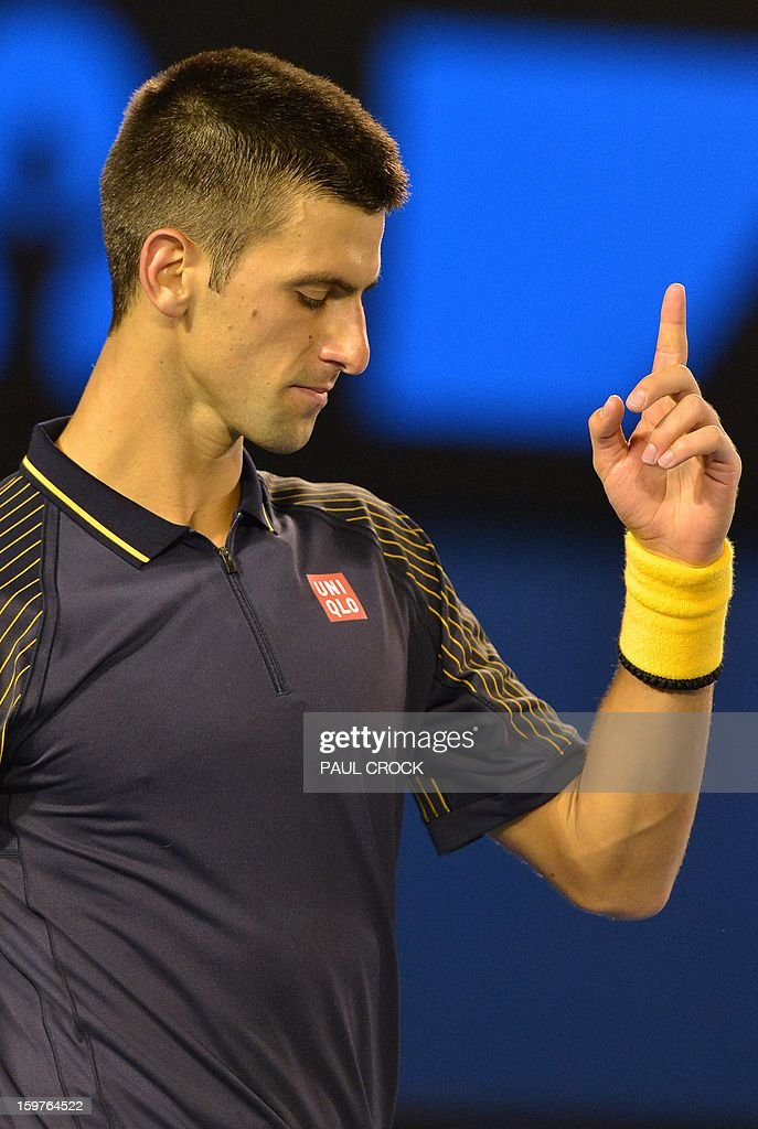 Serbia's Novak Djokovic gestures after a point against Switzerland's Stanislas Wawrinka during their men's singles match on day seven of the Australian Open tennis tournament in Melbourne early on January 21, 2013.
