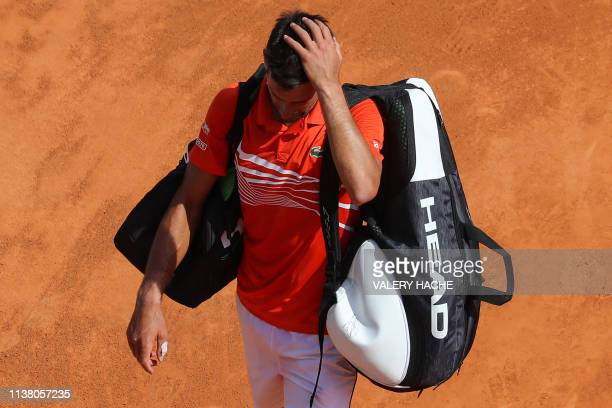 TOPSHOT Serbia's Novak Djokovic gestures as he leaves after losing the quarter final tennis match against Russia's Daniil Medvedev on the day 7 of...