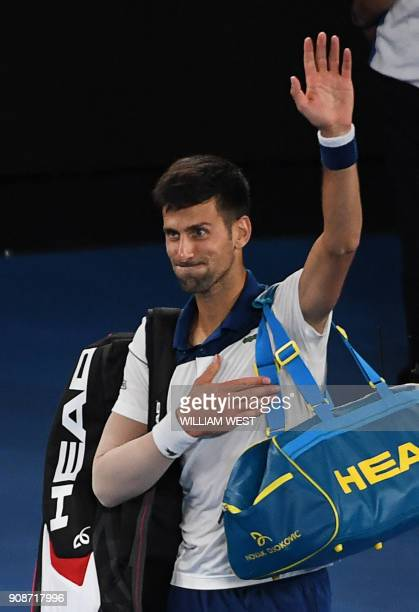 Serbia's Novak Djokovic gestures as he leaves the court following his loss to South Korea's Hyeon Chung in their men's singles fourth round match on...