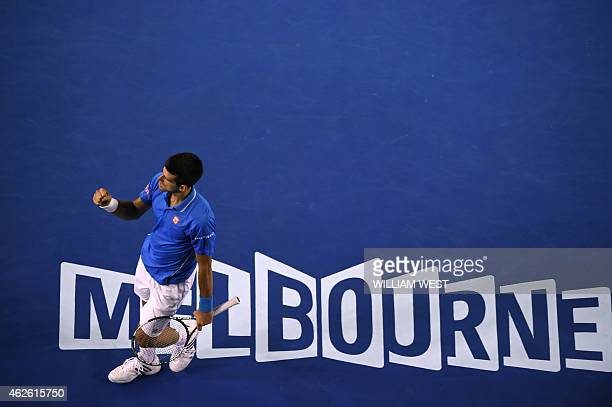 Serbia's Novak Djokovic gestures as he walks on court during his men's singles final match against Britain's Andy Murray on day fourteen of the 2015...