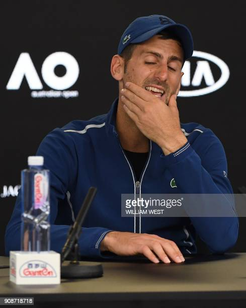 Serbia's Novak Djokovic gestures during a press conference after his loss to South Korea's Hyeon Chung in their men's singles fourth round match on...