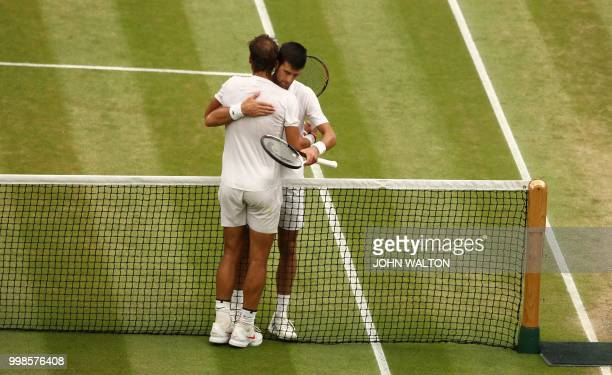 Serbia's Novak Djokovic greets Spain's Rafael Nadal after winning their men's singles semifinal match on the twelfth day of the 2018 Wimbledon...