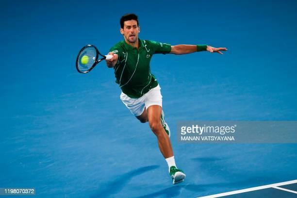 Serbia's Novak Djokovic hits a return against Austria's Dominic Thiem during their men's singles final match on day fourteen of the Australian Open...