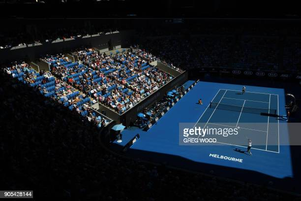 Serbia's Novak Djokovic hits a return against Donald Young of the US during their men's singles first round match on day two of the Australian Open...