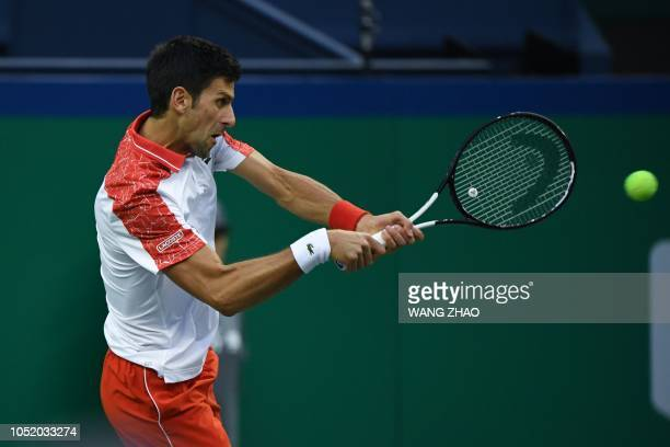 Serbia's Novak Djokovic hits a return against Germany's Alexander Zverev during their men's singles semifinals match at the Shanghai Masters tennis...