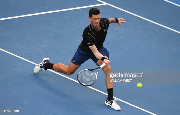 TOPSHOT Serbia's Novak Djokovic hits a return against Spain's Albert RamosVinolas during their men's singles third round match on day six of the...