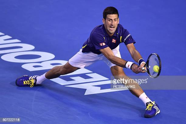 Serbia's Novak Djokovic hits a return during his men's singles semi-final match against Switzerland's Roger Federer on day eleven of the 2016...