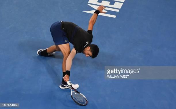 TOPSHOT Serbia's Novak Djokovic hits a return during their men's singles third round match against Spain's Albert RamosVinolas on day six of the...