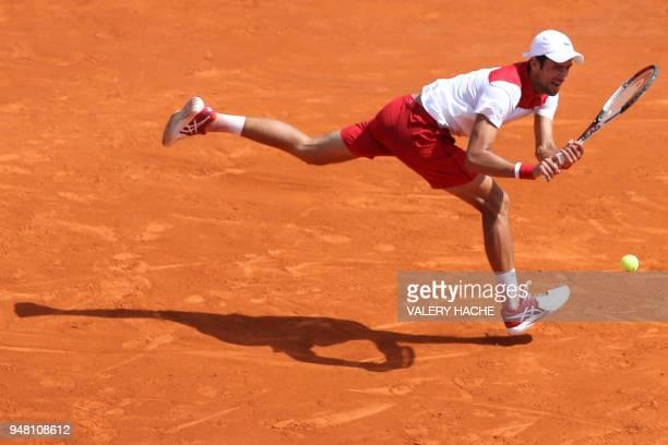 Serbia's Novak Djokovic hits a return to Croatia's Borna Coric during their men's single tennis match at the MonteCarlo ATP Masters Series Tournament...