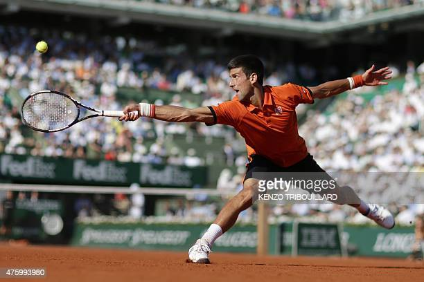 Serbia's Novak Djokovic hits a return to Great Britain's Andy Murray during their men's semifinal match of the Roland Garros 2015 French Tennis Open...