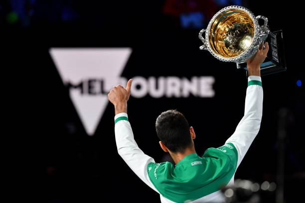 Serbia's Novak Djokovic holds the Norman Brookes Challenge Cup trophy after beating Russia's Daniil Medvedev to win their men's singles final match...