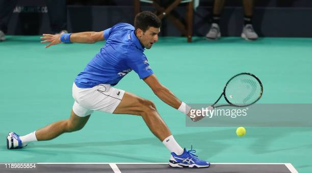 Serbia's Novak Djokovic in action against Greece's Stefanos Tsitsipas during the Mubadala World Tennis Championship at Zayed Sports City in Abu Dhabi...