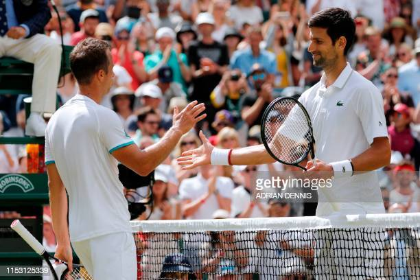 Serbia's Novak Djokovic is congratulated by Germany's Philipp Kohlschreiber after winning their men's singles first round match on the first day of...