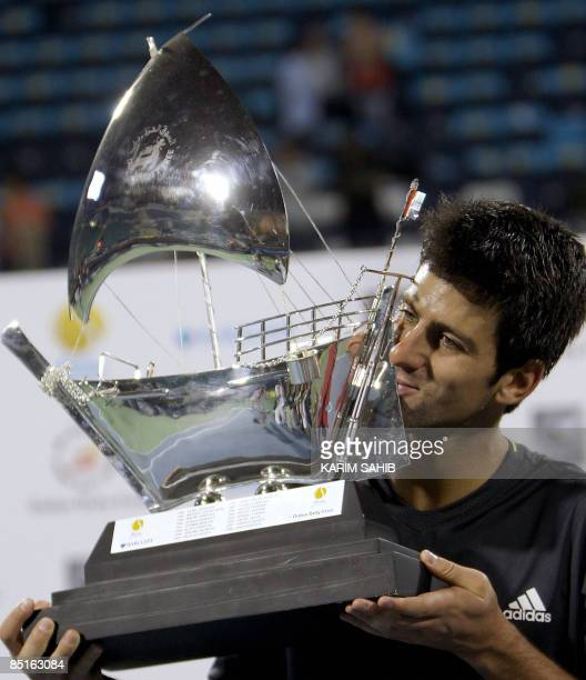 Serbia's Novak Djokovic kisses his trophy after winning the ATP Dubai tennis championships in the Gulf emirate on February 28 2009 Djokovic closed up...