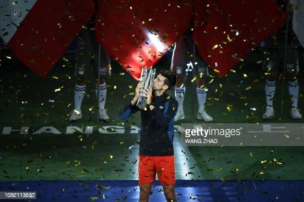 Serbia's Novak Djokovic kisses the trophy after winning his men's final singles match against Croatia's Borna Coric at the Shanghai Masters tennis...