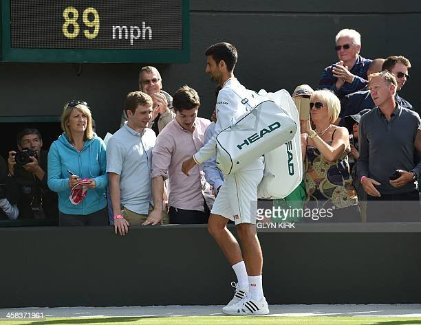 Serbia's Novak Djokovic leaves the court after losing to US player Sam Querrey in their men's singles third round match on the sixth day of the 2016...
