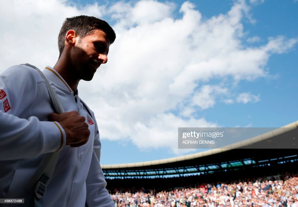 Serbia's Novak Djokovic leaves the court after losing to US player Sam Querrey during their men's singles third round match on the sixth day of the 2016 Wimbledon Championships at The All England Lawn Tennis Club in Wimbledon, southwest London, on July 2, 2016. /