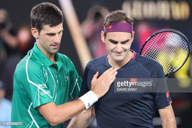 Serbia's Novak Djokovic pats Switzerland's Roger Federer after his victory during their men's singles semi-final match on day eleven of the...