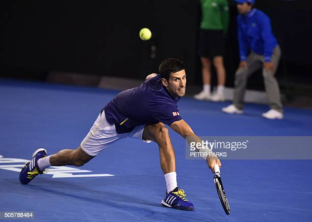 Serbia's Novak Djokovic plays a backhand return during his men's singles match against France's Quentin Halys on day three of the 2016 Australian...