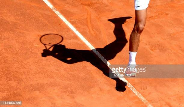 Serbia's Novak Djokovic plays a backhand return to Canada's Denis Shapovalov during their ATP Masters tournament tennis match at the Foro Italico in...