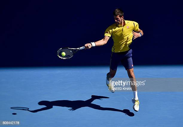 TOPSHOT Serbia's Novak Djokovic plays a forehand return during his men's singles match against South Korea's Chung Hyeon on day one of the 2016...