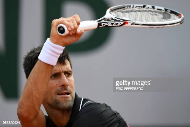 Serbia's Novak Djokovic plays a forehand return to Italy's Marco Cecchinato during their men's singles quarterfinal match on day ten of The Roland...