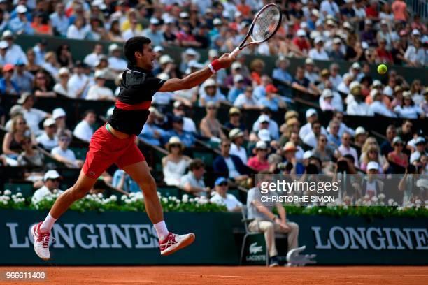 Serbia's Novak Djokovic plays a forehand return to Spain's Fernando Verdasco during their men's singles fourth round match on day eight of The Roland...