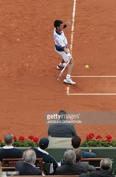 Serbia's Novak Djokovic plays a return during his men's fourth round match against US Robby Ginepri in the French Open tennis championship at the...