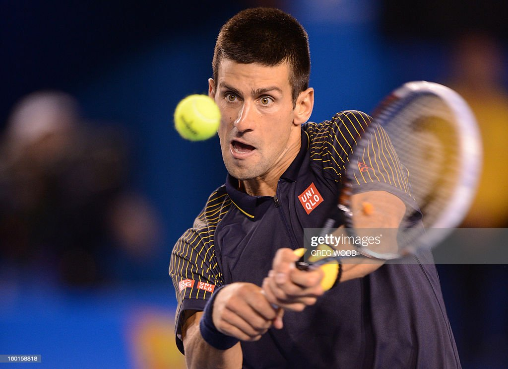 Serbia's Novak Djokovic plays a return during his men's singles final against Britain's Andy Murray on day fourteen of the Australian Open tennis tournament in Melbourne on January 27, 2013.