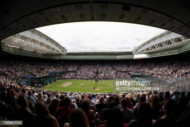 Serbia's Novak Djokovic plays against Italy's Matteo Berrettini during their men's singles final match on Center Court on the thirteenth day of the...